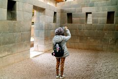 Female tourist taking pictures inside Coricancha, the Temple of the Sun of the Incas in Cusco, Peru stock photo
