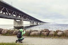 Female tourist taking pictures  the Oresund bridge Royalty Free Stock Photos