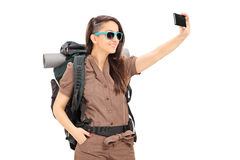 Female tourist taking selfie with cell phone. Isolated on white background royalty free stock photo