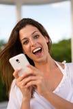 Female tourist texting on smartphone Royalty Free Stock Photos