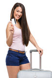 Female tourist with travel suitcase and credit card Royalty Free Stock Images