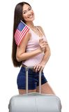Female tourist with travel suitcase and USA flag Stock Photo