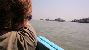 Female tourist traveling by boat stock video