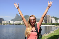 Female tourist traveling at Rio de Janeiro with Christ Redeemer. Blond young tourist female backpacker  traveling at Rio de Janeiro with the Christ Redeemer in Stock Photos