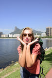 Female tourist traveling at Rio de Janeiro with Christ the Redeemer. Blond young tourist female backpacker  traveling at Rio de Janeiro with Christ the Redeemer Royalty Free Stock Image
