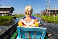 Female tourist travels by traditional boat. Royalty Free Stock Images