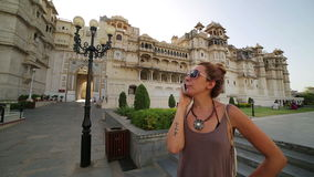 Female tourist at Udaipur Palace stock footage