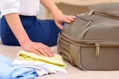 Female tourist unpacking her baggage Stock Photo