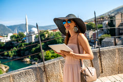 Female tourist using digital tablet in Mostar city Royalty Free Stock Image