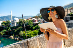Female tourist using digital tablet in Mostar city Royalty Free Stock Photography