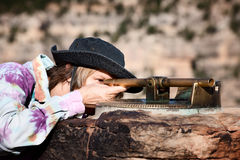 Female Tourist Viewing the Grand Canyon Royalty Free Stock Image
