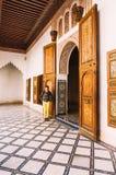 Female tourist visiting Bahia Palace in Marrakech - Morocco. Smiling female tourist enjoying the interiors of the Bahia Palace in Marrakech - Morocco royalty free stock image
