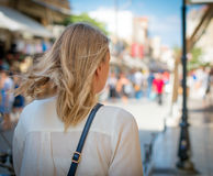 Female tourist walking in the city. Stock Photo