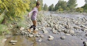 Female tourist walking on rocks stock footage