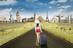 Female tourist walking to famous landmarks Royalty Free Stock Images