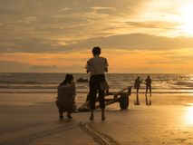Female Tourist Watching Sunset in a Beach. Located in Cenang Beach, Langkawi, Malaysia Royalty Free Stock Images