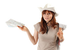 Female tourist in white hat with map Royalty Free Stock Photos