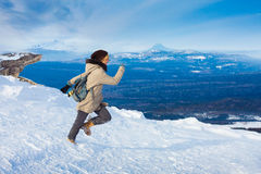 Female tourist at the winter mountains Stock Photography