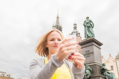 Young beautiful woman on the background of the St. Mary`s Church in Krakow royalty free stock photos