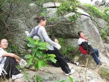 The female Tourists climb hillstone in SHENZHEN Stock Photo
