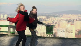 Female tourists jump and enjoy the view. Two young women stop for a magnificient view over Ljubljana city stock video