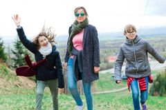 Female tourists reaching top - finishing long uphill trip stock photos