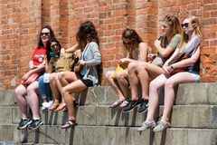 Female tourists are resting in St. Mark`s Square in Venice. Venice, Italy - May 19, 2017: Female tourists are resting by the Campanile in the Piazza San Marco St stock photos