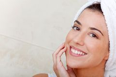 Female with a towel on her head Stock Image