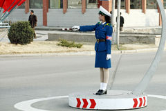Female traffic police.DPRK. Beautiful female traffic police on the street in Pyongyang. but automobile are very few here (April 15, 2010 Stock Photo