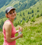 Female trail runner drinking water Royalty Free Stock Photos