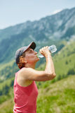 Female trail runner drinking water Royalty Free Stock Image