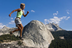 Female trail runner jumping. Stock Photography