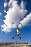 Female trail runner jumping. Royalty Free Stock Photos