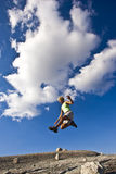 Female trail runner jumping. Royalty Free Stock Photography