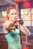 Female trainer blowing whistle Royalty Free Stock Image