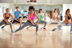 Female trainer doing exercises with fitness group stock photography