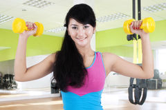 Female trainer exercising with dumbbells Stock Images
