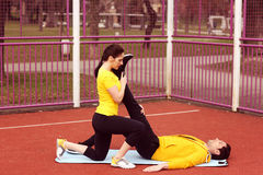 Female trainer with man exercising Stock Photos