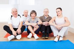 Female trainer with senior customers at gym Royalty Free Stock Photo