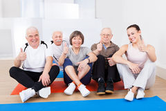 Female Trainer With Senior Customers At Gym Stock Images