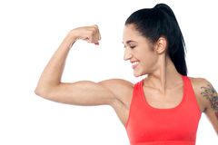 Female trainer showing her biceps Stock Photo