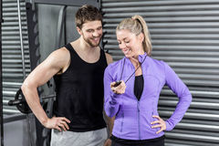 Female trainer showing timer. At crossfit gym Royalty Free Stock Photos