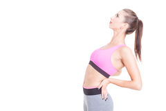 Female trainer stretching her back preparing for workout Stock Photo