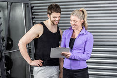 Female trainer talking with client. At crossfit gym Stock Images