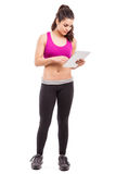 Female trainer using a tablet Stock Image