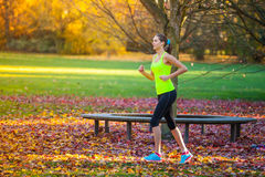 Female training outside during autumn day. Royalty Free Stock Photos