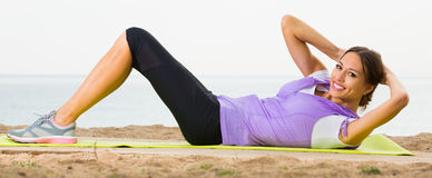 Female training  on sea beach on morning and smiling Royalty Free Stock Photography