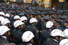 Female transit police watching a parade Stock Image