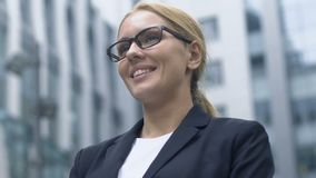 Female translator waiting for foreign business partners near office entrance. Stock footage stock footage
