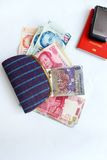 Female Traveler in asia concept. A concept photograph showing a female cloth canvas purse with assorted currency bank notes from different asia countries royalty free stock photos
